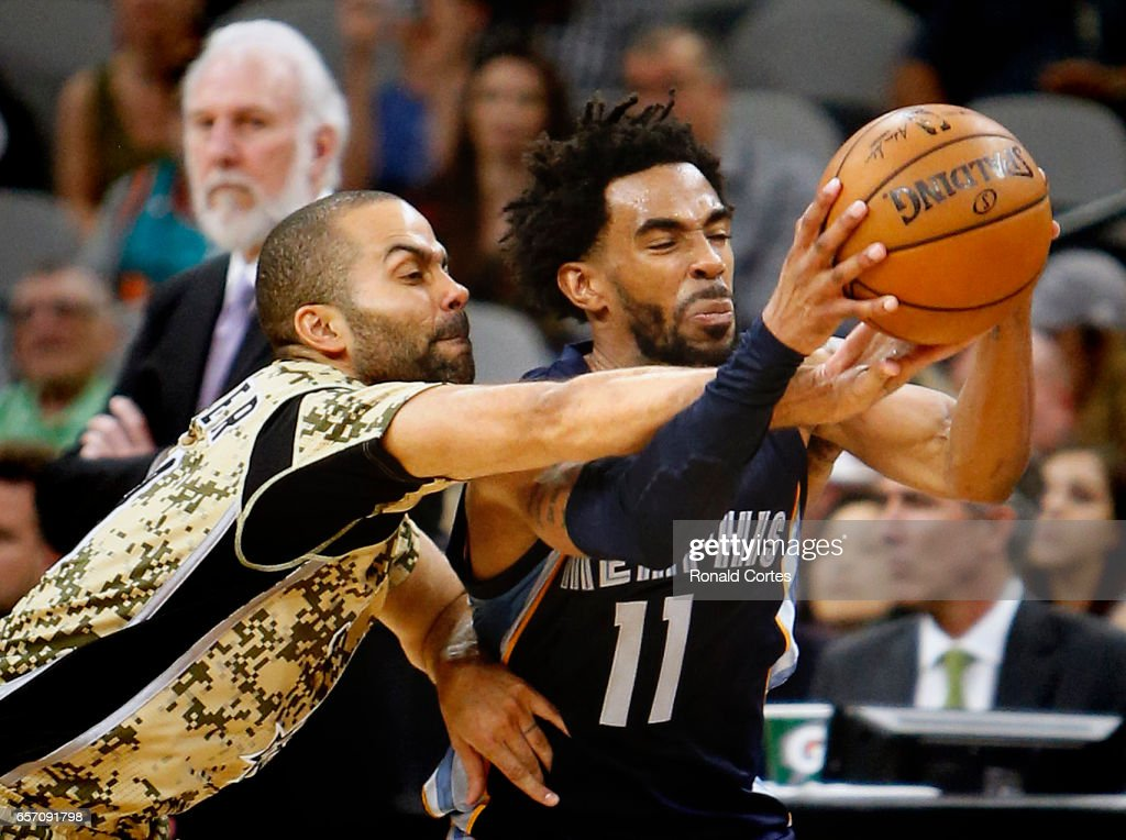 Tony Parker #9 of the San Antonio Spurs tries to make a steal against Mike Conley #11 of the Memphis Grizzlies at AT&T Center on March 23, 2017 in San Antonio, Texas.