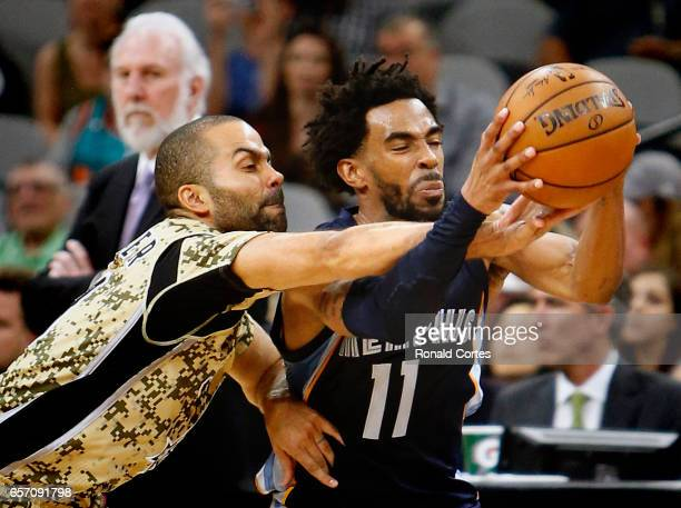 Tony Parker of the San Antonio Spurs tries to make a steal against Mike Conley of the Memphis Grizzlies at ATT Center on March 23 2017 in San Antonio...