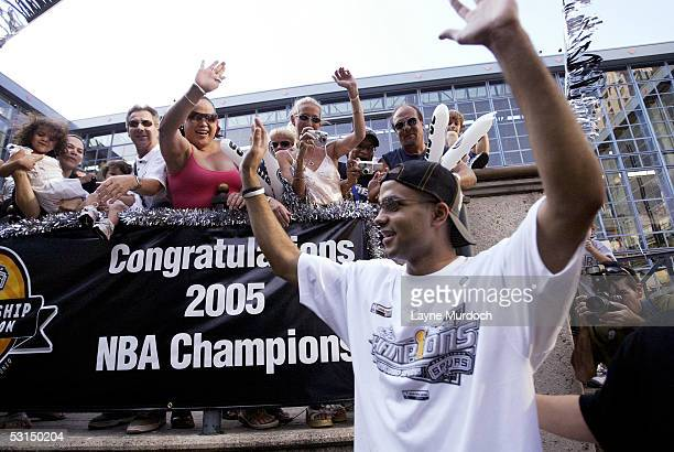 Tony Parker of the San Antonio Spurs waves to fans lined up along the San Antonio River during the victory parade June 25, 2005 in San Antonio,...