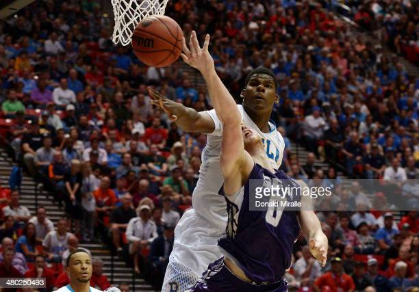 Tony Parker of the UCLA Bruins blocks a shot by Thomas Walkup of the Stephen F Austin Lumberjacks inthe second half during the third round of the...
