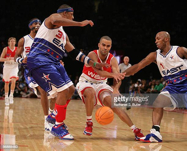 Tony Parker of the Western Conference looses the ball against the defense of Paul Pierce and Chauncey Billups of the Eastern Conference during the...