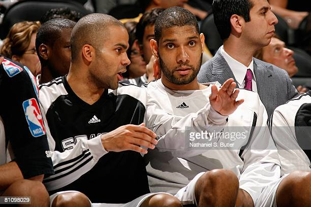 Tony Parker talks to teammateTim Duncan of the San Antonio Spurs on the bench in Game Four of the Western Conference Semifinals against the New...