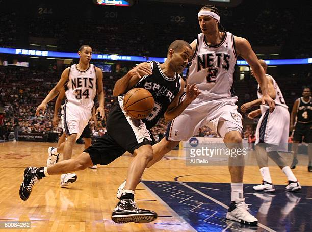 Tony Parker the San Antonio Spurs drives to the basket as Josh Boone of the New Jersey Nets defends during their game on March 2 2008 at the Izod...
