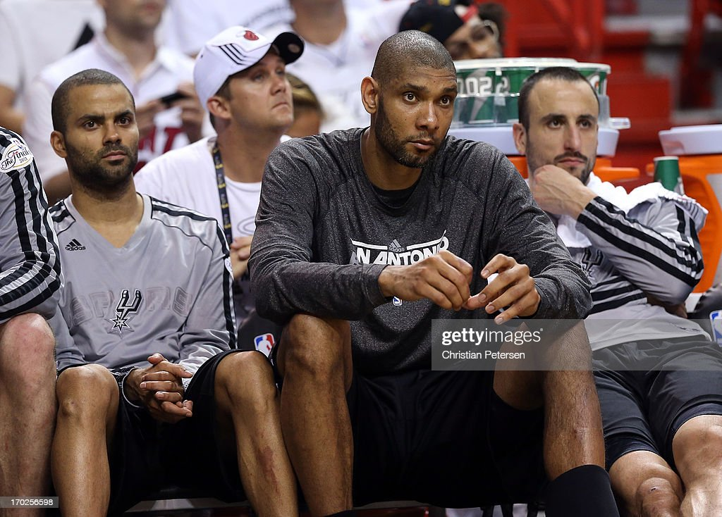 Tony Parker #9, Tim Duncan #21 and Manu Ginobili #20 of the San Antonio Spurs sit on the bench late in the fourth quarter while taking on the Miami Heat during Game Two of the 2013 NBA Finals at AmericanAirlines Arena on June 9, 2013 in Miami, Florida.