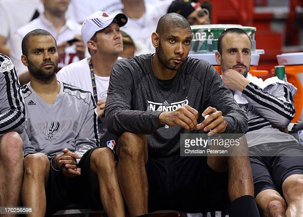 Tony Parker Tim Duncan and Manu Ginobili of the San Antonio Spurs sit on the bench late in the fourth quarter while taking on the Miami Heat during...