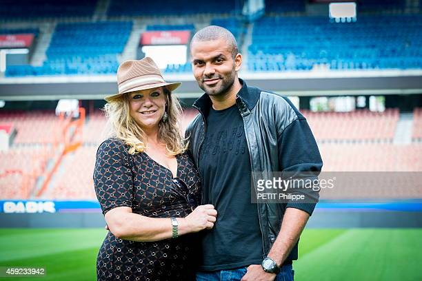 Tony Parker with his mother Pamela Firestone at the Parc des Prince on september 17 2014 in Paris France