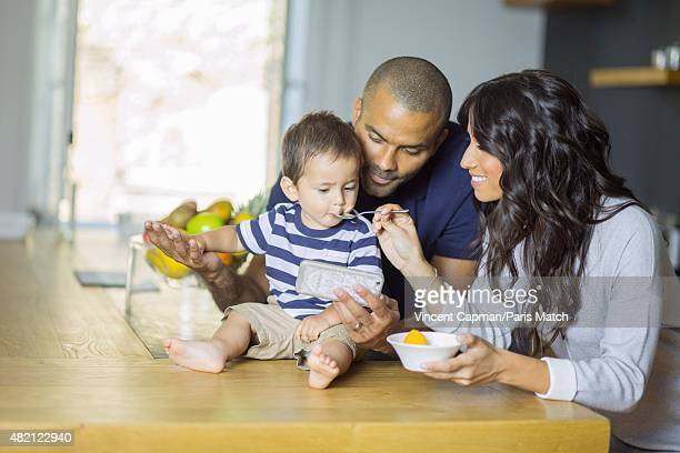 Tony Parker with his wife Axelle Francine and their son Josh are photographed for Paris Match in their new property on july 15 2015 in near LyonFrance
