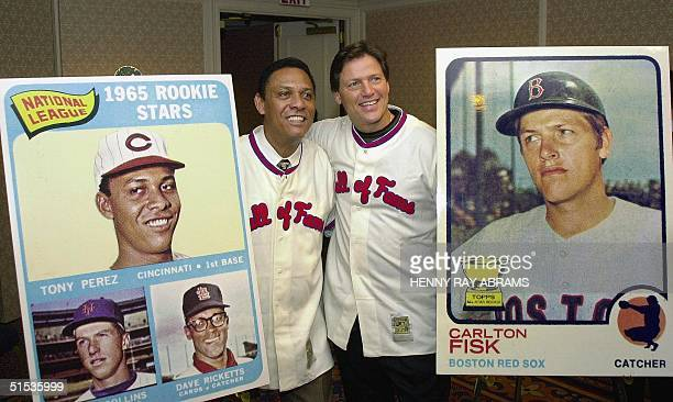 Tony Perez and Carlton Fisk pose with their respective baseball cards after a news conference in New York 12 January where they discussed their...