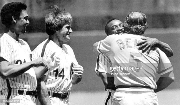 Tony Perez and Pete Rose of the Philadelphia Phillies look on as teammate Joe Morgan hugs their former teammate Johnny Bench of the Cincinnati Reds...