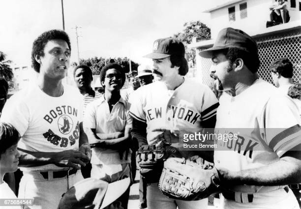 Tony Perez of the Boston Red Sox talks with Luis Tiant and Ed Figueroa of the New York Yankees during a baseball clinic on Novemer 17 1979 in San...