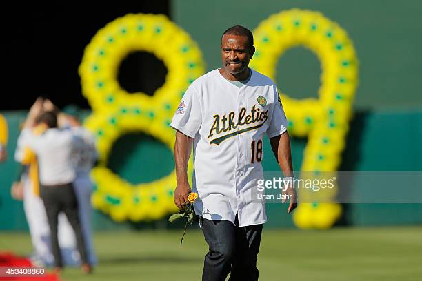 Tony Phillips of the 1989 Oakland A's joins his teammates as they celebrate their World Series championship of 25 years ago against the San Francisco...