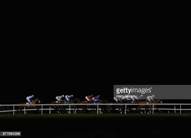 Tony Piccone riding London Protocol leads the British stallion studs ebf hyde stakes during the at Kempton Park on November 22 2017 in Sunbury England