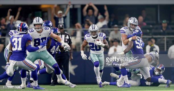 Tony Pollard of the Dallas Cowboys carries the ball against the New York Giants in the second half at ATT Stadium on September 08 2019 in Arlington...