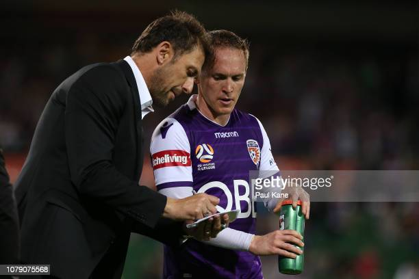 Tony Popovic head coach of the Glory talks with Neil Kilkenny of the Glory at a break in play during the round seven ALeague match between the Perth...