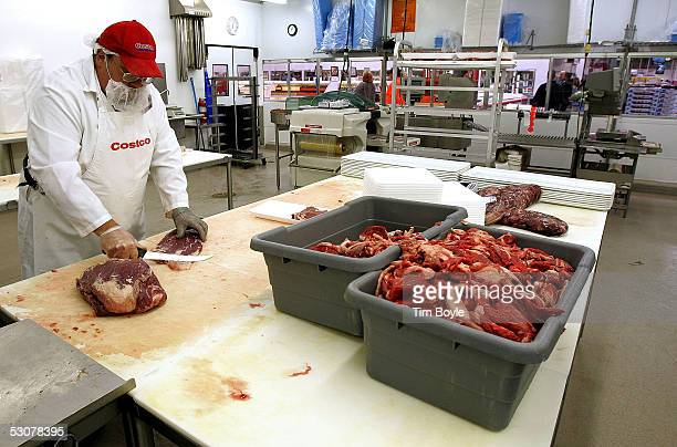Tony Prerost cuts up premium Kirkland Signature meat at a Costco store June 16 2005 in Niles Illinois The larger 'big box' stores such as Costco...