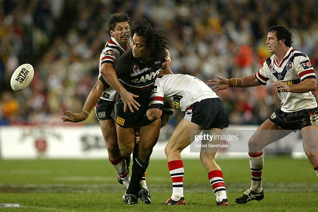 Tony Puletua #12 of the Panthers offloads a pass during the NRL Grand Final between the Sydney Roosters and the Penrith Panthers at Telstra Stadium October 5, 2003 in Sydney, Australia. Penrith won 18-6.