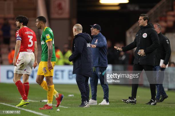Tony Pulis clashes with Preston North End manager Alex Neil after he kicked the ball away from George Friend of Middlesbrough during added time...