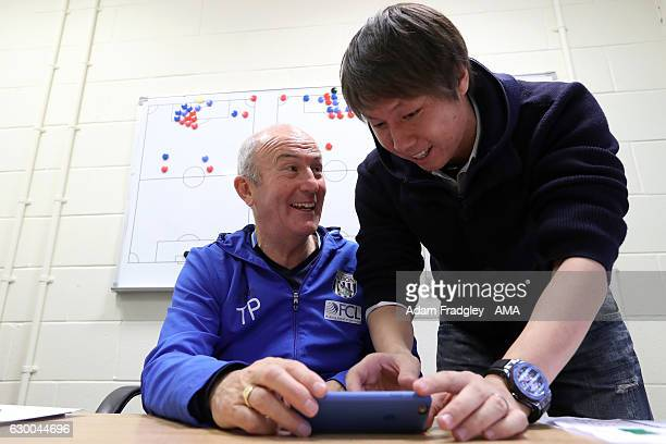 Tony Pulis head coach / manager of West Bromwich Albion meets with Li Tie former Premier League player with Everton and the current Chinese Assistant...