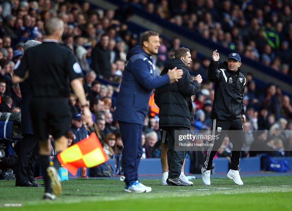 Tony Pulis, manager of West Brom (R) shows his frustrations with the fourth official after the second goal of Brown Ideye of West Brom is disallowed during the Barclays Premier League match between West Bromwich Albion and Stoke City at The Hawthorns on March 14, 2015 in West Bromwich, England.