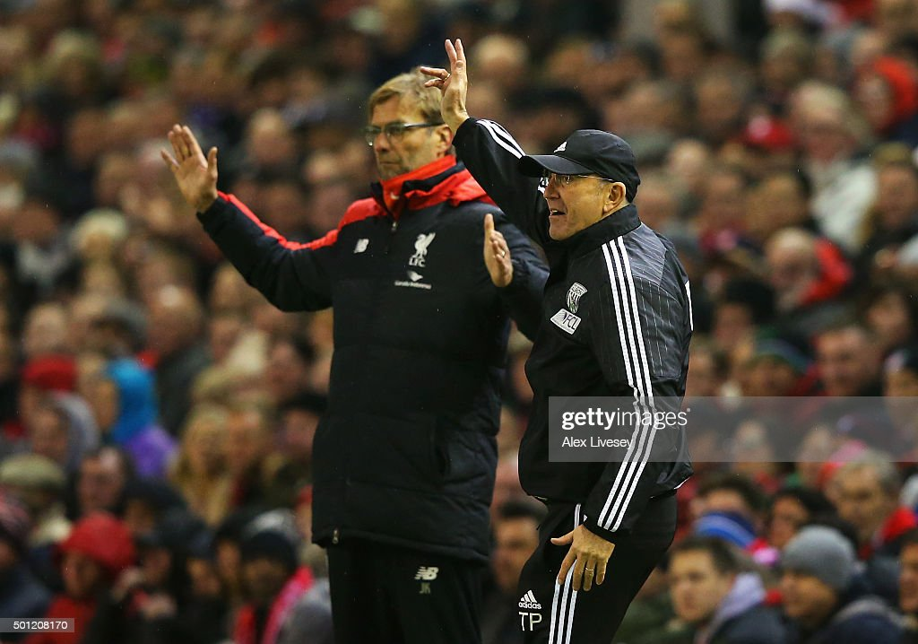 Tony Pulis manager of West Bromwich Albion and Jurgen Klopp, manager of Liverpool react during the Barclays Premier League match between Liverpool and West Bromwich Albion at Anfield on December 13, 2015 in Liverpool, England.