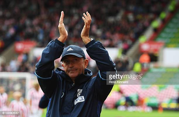 Tony Pulis Manager of West Bromwich Albion claps the fans beofre his 1000th game as a manager during the Premier League match between Stoke City and...