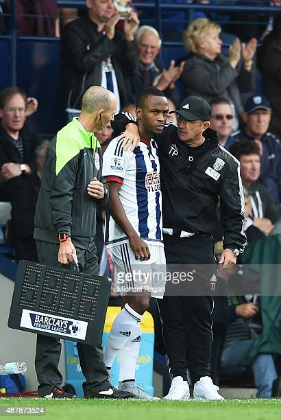 Tony Pulis manager of West Bromwich Albion talks to Saido Berahino as he comes on as a substitute during the Barclays Premier League match between...