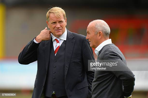 Tony Pulis, Manager of West Bromwich Albion talks with colin Gordon, Chairman of Kidderminster Harriers during the Pre-Season Friendly match between...