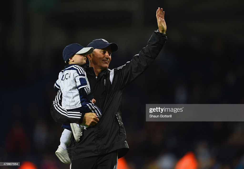 Tony Pulis manager of West Bromwich Albion walks on the pitch with grandson Luca after the Barclays Premier League match between West Bromwich Albion and Chelsea at The Hawthorns on May 18, 2015 in West Bromwich, England.