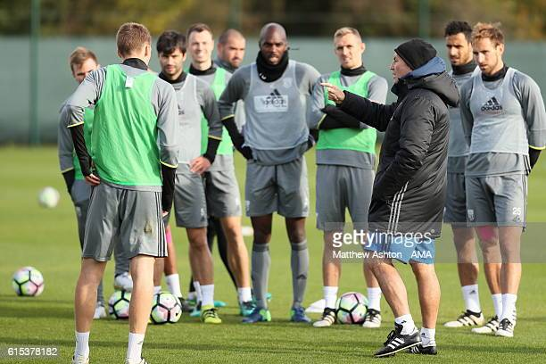 Tony Pulis the head coach / manager of West Bromwich Albion speaks to his players during a training session on October 18 2016 in West Bromwich...