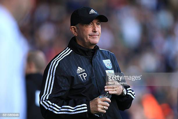 Tony Pulis the manager of West Brom looks on during the Barclays Premier League match between West Bromwich Albion and Liverpool at The Hawthorns on...