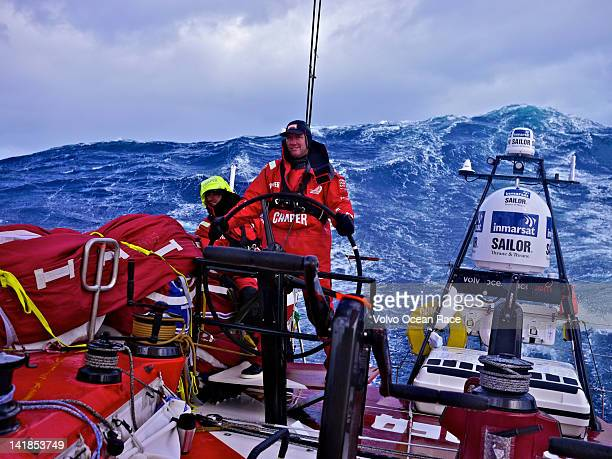 Tony Rae of New Zealand nursing the boat through monster Southern Ocean waves onboard CAMPER with Emirates Team New Zealand during leg 5 of the Volvo...