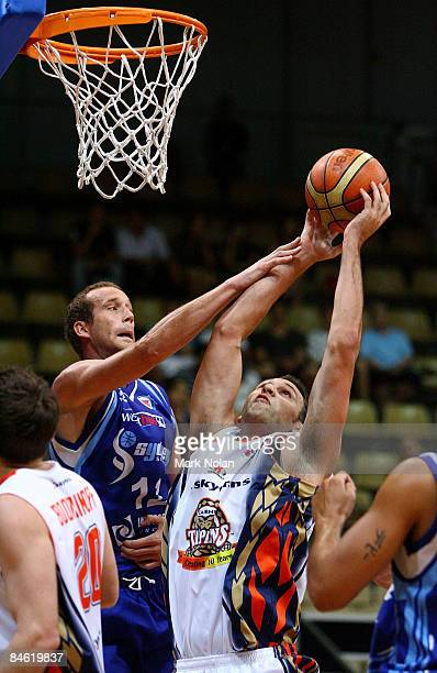 Tony Rampton of the Spirit fouls Matt Smith of the Taipans during the round 21 NBL match between the Sydney Spirit and the Cairns Taipans held at...