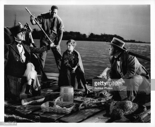 Tony Randall Archie Moore Eddie Hodges and Mickey Shaughnessy are raftmates down the Mississippi River in a scene from the film 'The Adventures Of...