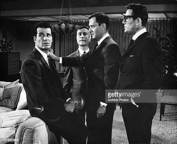 Tony Randall puts his hand on James Garner with Howard Duff behind them in a scene from the film 'Boys' Night Out' 1962