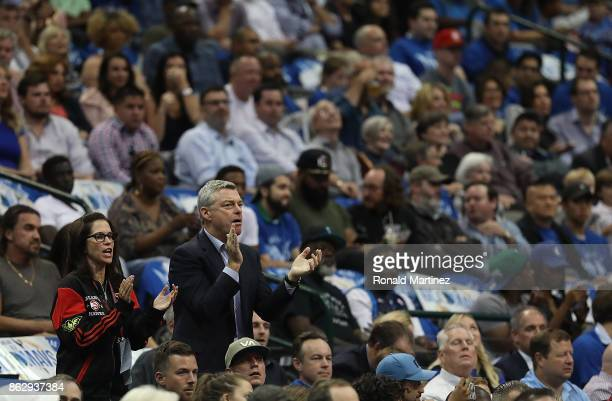 Tony Ressler owner of the Atlanta Hawks and Jami Gertz cheer during a game against the Dallas Mavericks at American Airlines Center on October 18...