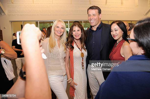 Tony Robbins poses with guests at the DuJour Media's Jason Binn Leslie Farrand and Fiona Murray hosted Screening and AfterParty at Parrish Art Museum...