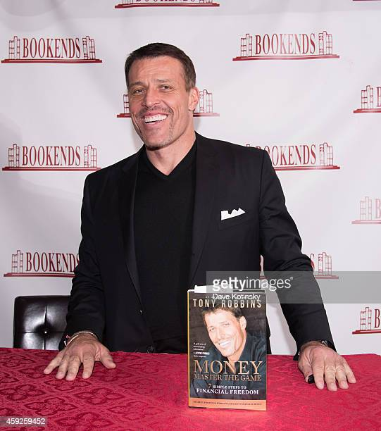 """Tony Robbins signs copies of his book """"Money: Master of the Game"""" at Bookends Bookstore on November 19, 2014 in Ridgewood, New Jersey."""