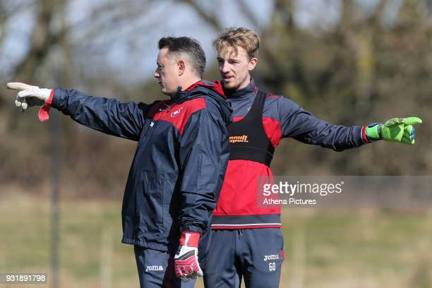 Tony Roberts goalkeeping coach and Lewis Thomas gesture during the Swansea City Training at The Fairwood Training Ground on March 13 2018 in Swansea...