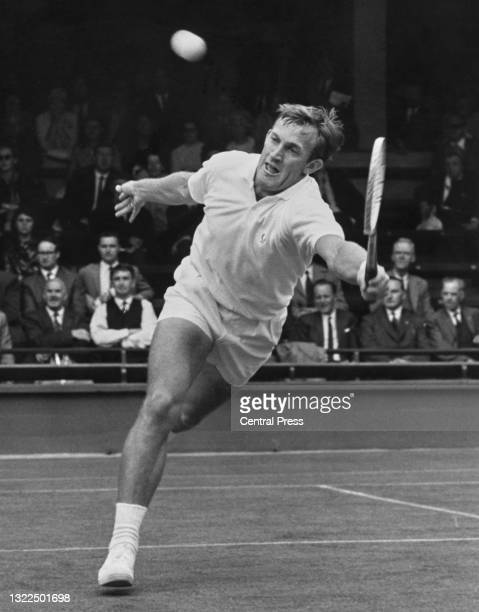 Tony Roche of Australia plays a running forehand return against Jan Kodes of Czechoslovakia during their Men's Singles First Round match at the...