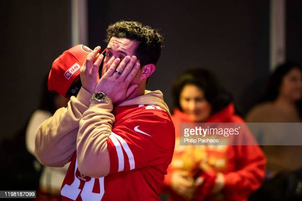 Tony Rodriguez of Concord, California reacts while watching the San Francisco 49ers play the Kansas City Chiefs during a Super Bowl LIV watch party...