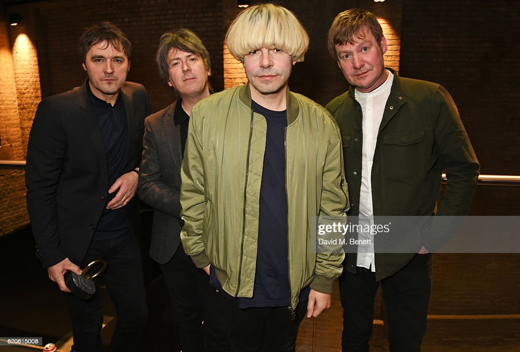 Tony Rogers, Mark Collins, Tim Burgess and Martin Blunt of The Charlatans, winners of the Q Classic Album award for 'Tellin' Stories', pose at The Stubhub Q Awards 2016 at The Roundhouse on November 2, 2016 in London, England.