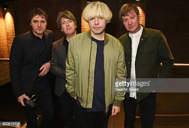 Tony Rogers Mark Collins Tim Burgess and Martin Blunt of The Charlatans winners of the Q Classic Album award for Tellin' Stories pose at The Stubhub...