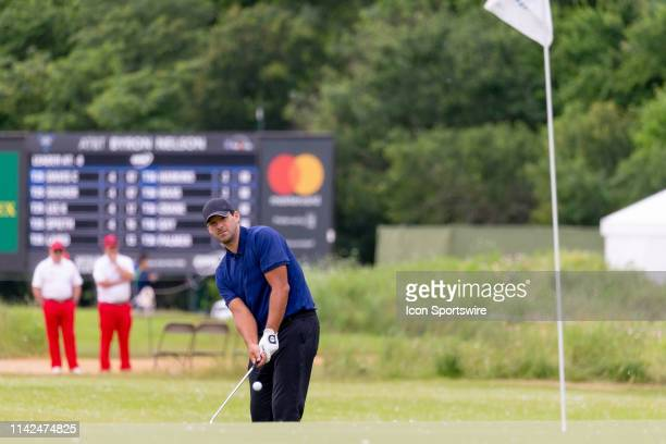 Tony Romo chips from just off the 13th green during the first round of the AT&T Byron Nelson on May 9, 2019 at Trinity Forest Golf Club in Dallas, TX.
