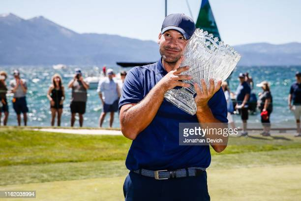 Tony Romo hugs the winner's trophy after winning the American Century Championship at Edgewood Tahoe Golf Course on July 14 2019 in Stateline Nevada