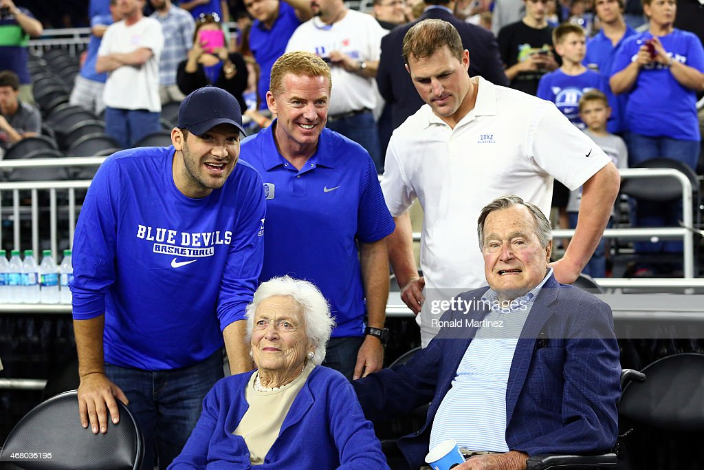 Tony Romo, Jason Garrett and Jason Witten of the Dallas Cowboys stand with former First Lady Barbara Bush and former President H.W. Bush prior to the South Regional Final of the 2015 NCAA Men's Basketball Tournament between the Duke Blue Devils and the Gonzaga Bulldogs at NRG Stadium on March 29, 2015 in Houston, Texas.