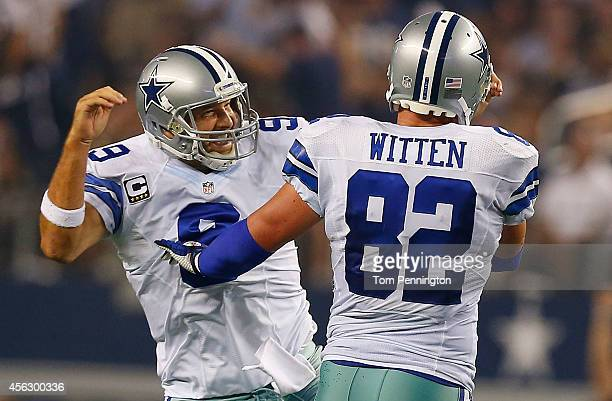 Tony Romo of the Dallas Cowboys and Jason Witten of the Dallas Cowboys celebrate after scoring a touchdown against the New Orleans Saints in the...