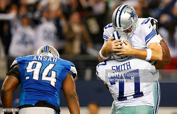 Tony Romo of the Dallas Cowboys and Tyron Smith of the Dallas Cowboys celebrate a Cowboy touchdown as Ezekiel Ansah of the Detroit Lions is near...