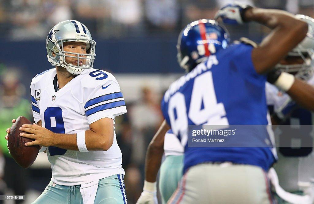 Tony Romo #9 of the Dallas Cowboys at AT&T Stadium on October 19, 2014 in Arlington, Texas.
