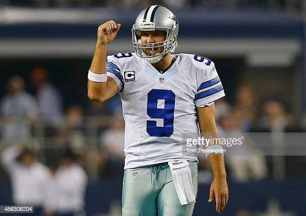 Tony Romo of the Dallas Cowboys celebrates a first down against the New Orleans Saints in the second half at AT&T Stadium on September 28, 2014 in...