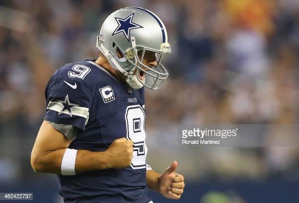 Tony Romo of the Dallas Cowboys celebrates a touchdown against the Oakland Raiders at ATT Stadium on November 28 2013 in Arlington Texas